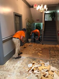 Technicians Removing Moldy Flooring